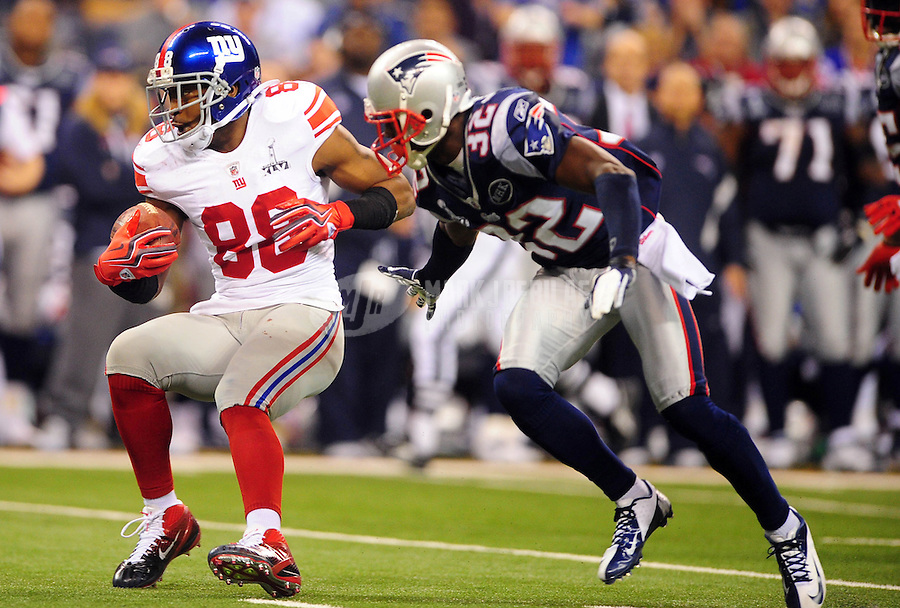 Feb 5, 2012; Indianapolis, IN, USA; New York Giants wide receiver Hakeem Nicks (88) runs past New England Patriots cornerback Devin McCourty (32) during the second half of Super Bowl XLVI at Lucas Oil Stadium.  Mandatory Credit: Mark J. Rebilas-