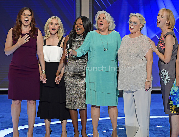 Debra Messings, Kristen Bell, Tyne Daly and other stars of Broadway sing &quot;What the World Needs Now is Love&quot; with  during the third session of the 2016 Democratic National Convention at the Wells Fargo Center in Philadelphia, Pennsylvania on Wednesday, July 27, 2016.<br /> Credit: Ron Sachs / CNP/MediaPunch<br /> (RESTRICTION: NO New York or New Jersey Newspapers or newspapers within a 75 mile radius of New York City)