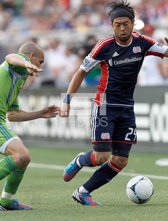 New England Revolution midfielder Lee Nguyen (24) dribbles. In a Major League Soccer (MLS) match, the New England Revolution tied the Seattle Sounders FC, 2-2, at Gillette Stadium on June 30, 2012.