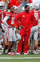 Ohio State Buckeyes quarterback Braxton Miller (5) stands beside wide receiver Philly Brown (10) in a warmup suit on the sideline during the third quarter of the NCAA football game at Ohio Stadium in Columbus on Sept. 21, 2013. (Adam Cairns / The Columbus Dispatch)