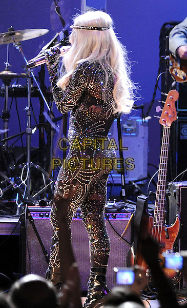 LADY GAGA.performing with We are Plastic Ono Band on night 2 at The Orpheum Theatre in Downtown Los Angeles, California, USA, October 2nd, 2010..music concert gig half 3/4 length microphone head band sparkly black fishnet catsuit gem jewel encrusted diamante gloves   back rear behind side                                                           .CAP/RKE/DVS.©DVS/RockinExposures/Capital Pictures.