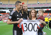 Washington, D.C.- March 29, 2014. Davy Arnaud (8) of D.C. United with family celebrating his 300th game. D.C. United defeated the New England Revolution 2-0 during a Major League Soccer Match for the 2014 season at RFK Stadium.
