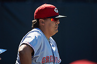 Greeneville Reds pitching coach Chad Cordero (32) watches the action from the dugout during the game against the Burlington Royals at Burlington Athletic Stadium on July 8, 2018 in Burlington, North Carolina. The Royals defeated the Reds 4-2.  (Brian Westerholt/Four Seam Images)