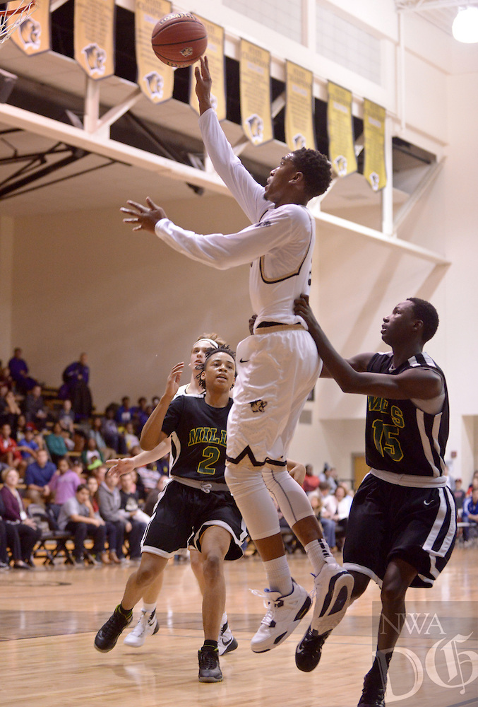 NWA Democrat-Gazette/BEN GOFF @NWABENGOFF<br /> Malik Monk of Bentonville makes a shot while being fouled by Branton McCrary of Little Rock Mills on Thursday Dec. 3, 2015 during the Crabtree Invitational tournament in Bentonville's Tiger Arena.