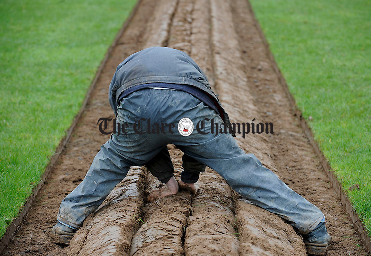 Getting the sod to sit just right at the Clare Ploughing Association's county championships at Newmarket On Fergus. Photograph by John Kelly.