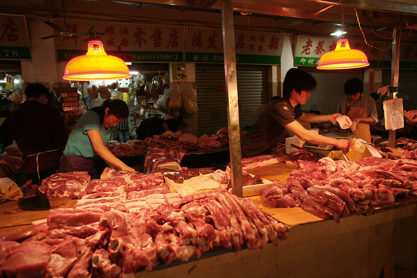 Vendors sell pork and beef in a Shenzhen April 1, 2006. Bird flu scares have reduced chicken consumption throughout the world. Shenzhen in is Guangdong Province