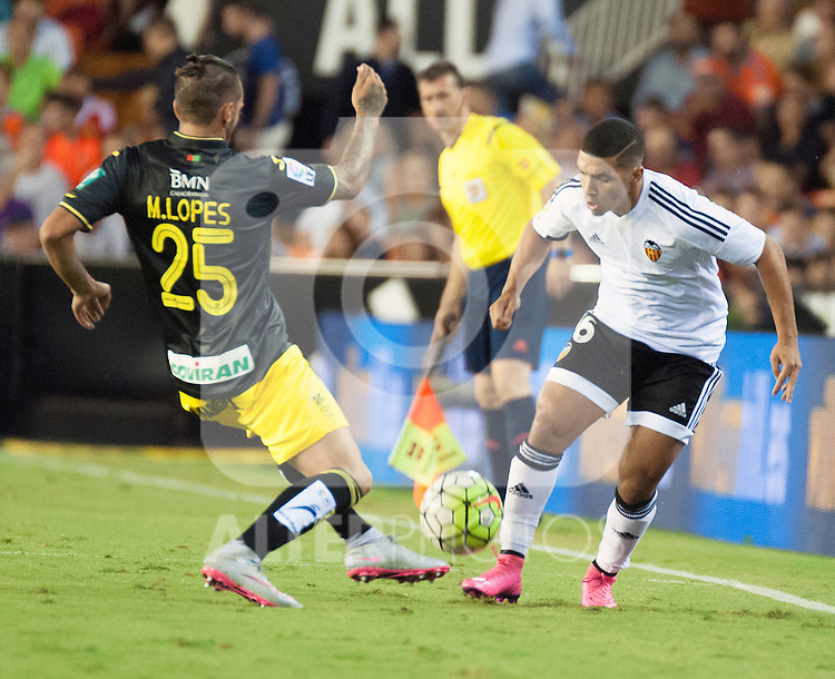Valencia's Bakkali (r) and Granada CF's Miguel Lopes (l) during La Liga match.September, 25. 2015. (ALTERPHOTOS/Javier Comos)