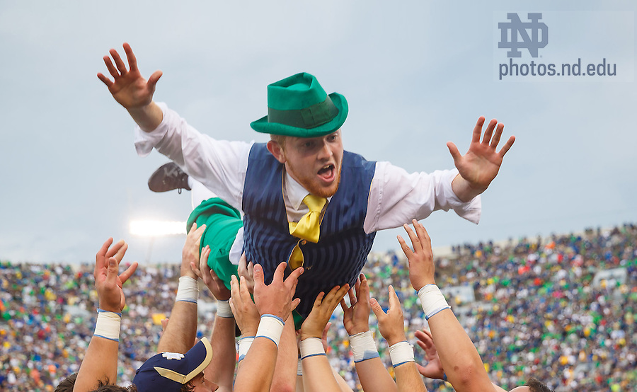 Aug. 30, 3014; The Leprechaun celebrates after a Notre Dame touchdown during the season opening football game against Rice..Photo by Peter Ringenberg/University of Notre Dame