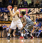 BROOKINGS, SD - JANUARY 18:  Brayden Carlson #12 from South Dakota State University looks at the defense of Devin Patterson #3 from Omaha in the first half of their Summit League game Saturday afternoon at Frost Arena in Brookings. (Photo by Dave Eggen/Inertia)