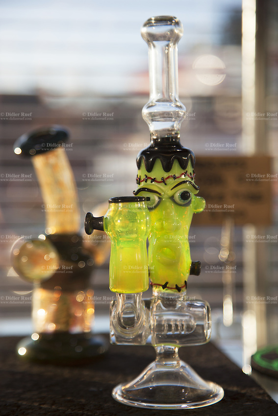 USA. Washington state. Seattle. Marijuana bongs for sale at Uncle Ike's. Uncle Ike's is authorized, according to cannabis legalization in Washington State, to sell marijuana as a retail store front. Uncle Ike's carries a wide variety of cannabis flowers, edibles, and concentrates for recreational marijuana, but also with a Pot Shop and a Glass & Goods store on-site. Uncle Ike's is the ultimate one-stop shop for recreational marijuana in the city of Seattle. Cannabis, commonly known as marijuana, is a preparation of the Cannabis plant intended for use as a psychoactive drug and as medicine. Pharmacologically, the principal psychoactive constituent of cannabis is tetrahydrocannabinol (THC); it is one of 483 known compounds in the plant, including at least 84 other cannabinoids, such as cannabidiol (CBD), cannabinol (CBN), tetrahydrocannabivarin (THCV), and cannabigerol (CBG). 13.12.2014 © 2014 Didier Ruef