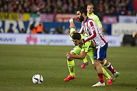 Atletico de Madrid´s Arda Turan and Barcelona´s Luis Suarez during 2014-15 Spanish King Cup match between Atletico de Madrid and Barcelona at Vicente Calderon stadium in Madrid, Spain. January 28, 2015. (ALTERPHOTOS/Luis Fernandez) /nortephoto.com<br />