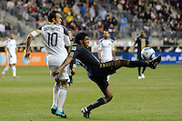 Sheanon Williams (25) of the Philadelphia Union plays the ball as Landon Donovan (10) of the Los Angeles Galaxy watches. The Los Angeles Galaxy defeated the Philadelphia Union  1-0 during a Major League Soccer (MLS) match at PPL Park in Chester, PA, on October 07, 2010.