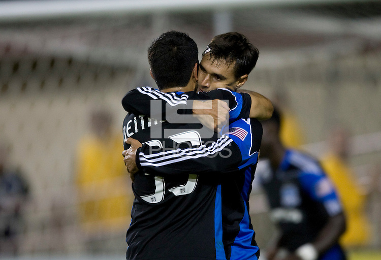 Chris Wondolowski of Earthquakes hugs Steven Beitashour after scoring a goal during the second half of the game against Kansas City at Buck Shaw Stadium in Santa Clara. California on October 1st, 2011.  San Jose Earthquakes tied Sporting Kansas City, 1-1.