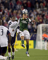 Portland Timbers midfielder Jack Jewsbury (13) battles for head ball. In a Major League Soccer (MLS) match, the New England Revolution tied the Portland Timbers, 1-1, at Gillette Stadium on April 2, 2011.