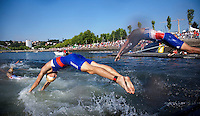 25 JUN 2011 - PONTEVEDRA, ESP - Alexander Bryukhankov (RUS) and Laurent Vidal (FRA) dive back into the water for the start of the second lap of the swim at the Elite Men's European Triathlon Championships in Pontevedra, Spain (PHOTO (C) NIGEL FARROW)