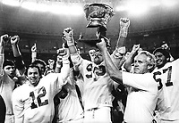 31 December 1978: Steve Dils (12), rdy Ceresino and Bill Walsh celebrate after Stanford's 25-22 win over Georgia in the Bluebonnet Bowl.