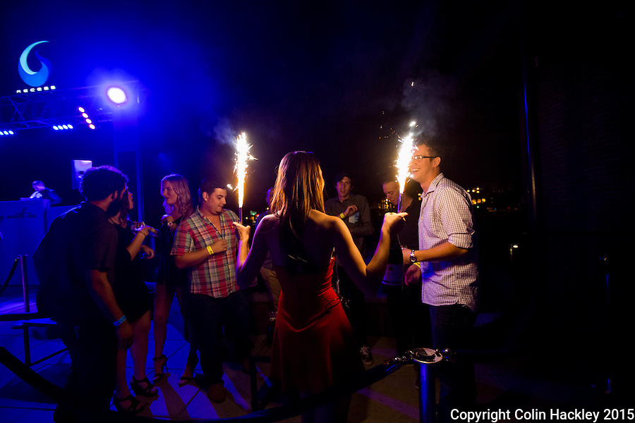 Sparkling champagne is delivered to a group celebrating at Recess, a rooftop club in Tallahassee's College Town area in the Gaines Street corridor.  <br /> <br /> COLIN HACKLEY PHOTO