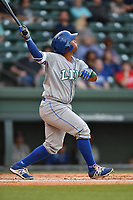 Catcher Meibrys Viloria (4) of the Lexington Legends bats in a game against the Greenville Drive on Wednesday, April 12, 2017, at Fluor Field at the West End in Greenville, South Carolina. Greenville won, 4-1. (Tom Priddy/Four Seam Images)
