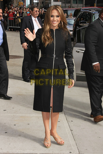 "JENNIFER LOPEZ.Jennifer Lopez (promoting ""The Back-Up Plan"") at the Ed Sullivan Theater for an appearance on the 'Late Show with David Letterman', New York, NY, USA>.April 19th, 2010.full length j-lo black coat jacket zip zipper hand palm waving clear plastic belt.CAP/LNC/TOM.©TOM/LNC/Capital Pictures."