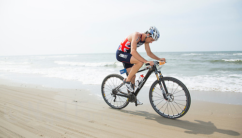 13 JUL 2013 - DEN HAAG, NED - Asa Shaw (GBR) of Great Britain races across the beach during the bike at the  2013 ITU Elite Men's Cross Triathlon World Championships in Kijkduin, Den Haag (The Hague), the Netherlands (PHOTO COPYRIGHT © 2013 NIGEL FARROW, ALL RIGHTS RESERVED)