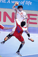 Egypt's Abou Elfetouh Ahmed (d) and Spain's Antonio Garcia Robledo during 23rd Men's Handball World Championship preliminary round match.January 14,2013. (ALTERPHOTOS/Acero) /NortePhoto