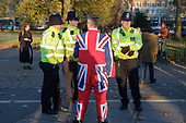 Police in high viz jackets and man with Union Jack suit, Speakers' Corner, Hyde Park, London.