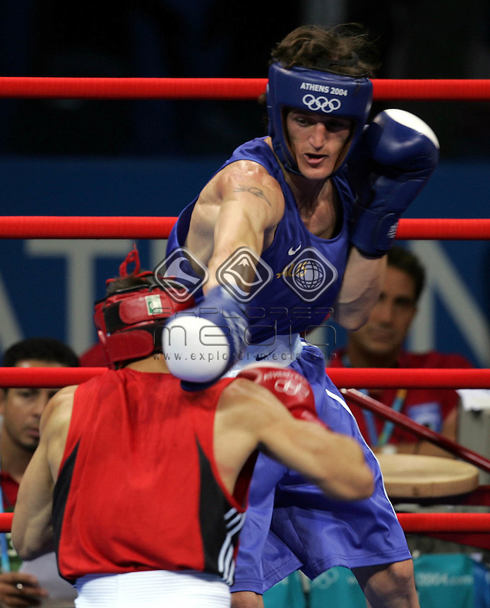 Ryan Langham (AUS) in blue throws a punch to Viorel Simion (ROM)<br /> Summer Olympics - Athens, Greece 2004<br /> Day 03, 16th August 2004.<br /> &copy; Sport the library/Sandra Teddy