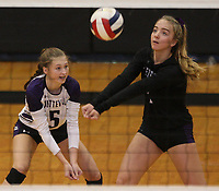Arkansas Democrat-Gazette/STATON BREIDENTHAL --10/29/19-- Fayetteville's Gracyn Spresser (right) hits the ball in front of teammate Sadie Thompson Tuesday during their game against Mount St. Mary Academy in the 6A state Volleyball Tournament in Cabot. See more photos at arkansasonline.com/1030volleyball6A/.