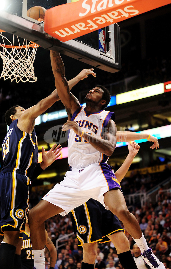 Dec. 3, 2010; Phoenix, AZ, USA; Phoenix Suns forward Earl Clark drives to the basket in the second half against the Indiana Pacers at the US Airways Center. The Suns defeated the Pacers 105-97. Mandatory Credit: Mark J. Rebilas-