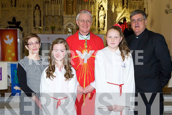 Douglas NS pupils Jane Carr left and Saskya von der Venter-Moroney with their teacher Kay Devane, Fr Fleming and Bishop Ray Browne at their Confirmation on Thursday in Killorglin