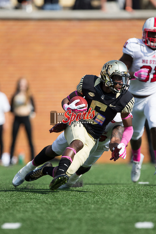 Tabari Hines (6) of the Wake Forest Demon Deacons returns a punt during first half action against the North Carolina State Wolfpack at BB&T Field on October 24, 2015 in Winston-Salem, North Carolina.  The Wolfpack defeated the Demon Deacons 35-17.   (Brian Westerholt/Sports On Film)