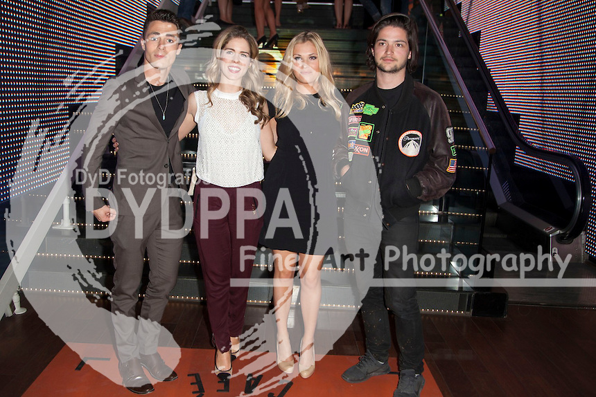 """The actors Thomas McDonell, Eliza Taylor, Colton Haynes and Emily Bett Rickards attends the fan event of the tv shows ARROW and THE 100, at the """"ATRESMEDIA CAFE""""   in Madrid, Spain. Jun 9, 2014. Photo by Nacho lopez/ DyD Fotografos-DYDPPA"""