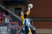 Goalkeeper Alex Cisak of Leyton Orient saves from Aaron Holloway of Wycombe Wanderers during the Sky Bet League 2 match between Leyton Orient and Wycombe Wanderers at the Matchroom Stadium, London, England on 19 September 2015. Photo by Andy Rowland.