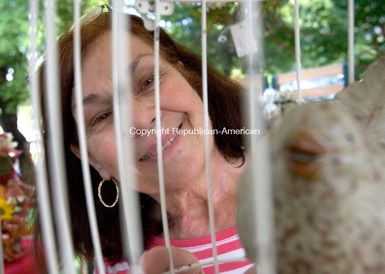 SOUTHBURY CT. 06 September 2014-090614SV05-Donna Scavone of Waterbury sells one of her bird cage designs during the 10th annual Fall Fine Arts Festival in Southbury Saturday. <br /> Steven Valenti Republican-American