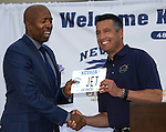 "Kenny ""The Jet"" Smith, left, receives a license plate from Nevada Governor Brian Sandoval during the 48th Annual Nevada Athletics Governor's Dinner at the Governor's Mansion  in Carson City on  Friday, July 8, 2016."