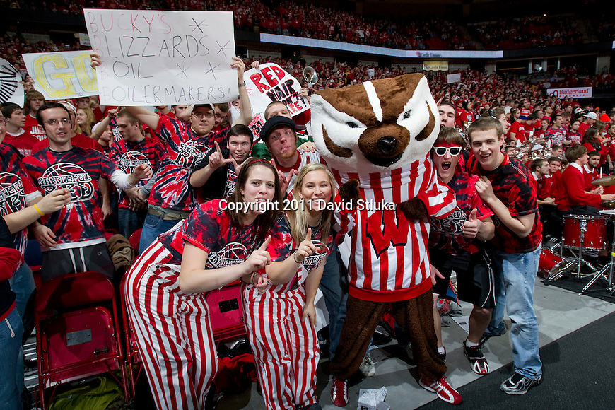Wisconsin Badgers mascot Bucky Badger poses with fans during a Big Ten Conference NCAA men's college basketball game against the Purdue Boilermakers on February 1, 2011 at the Kohl Center in Madison, Wisconsin. Wisconsin won 66-59. (Photo by David Stluka)