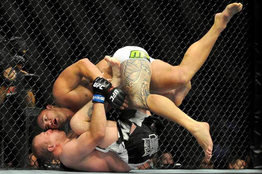 24 SEPTEMBER 2011:  Travis Browne in the octagon with Rob Broughton   during UFC 135 at the Pepsi Center in Denver, Colorado. *****For Editorial Use Only*****