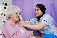Hospital Student Nurses and elderly patient on the ward