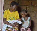 A mother with her three-week old newborn and daughter, six, inBatamuliza Hururiro village, near Rukumo Health Center, Rwanda....