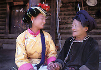 "Ai Li Zhi Ma, 19, and her 80-year-old grandmother, Ge Zhama, the head of her household of 13 people on Lugu Lake, Yunnan. Ge Zhama is the matriarch, the family elder and chief. Women from the Mosuo tribe do not marry, take as many lovers as they wish and have no word for ""father"" or ""husband"". But the arrival of tourism and the sex industry is changing their culture...PHOTO BY SINOPIX"