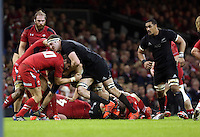Pictured: Brodie Retallick of New Zealand (with ball) is brought down by Dan Biggar of Wales Saturday 22 November 2014<br />