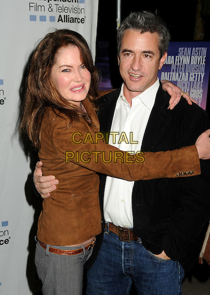 "LARA FLYNN BOYLE & DERMOT MULRONEY .""Where the Day Takes You"" IFTA Special Screening held at the Aero Theatre, 9th December 2010..half length brown suede smiling purple print black white shirt arm around .CAP/ADM/BP.©Byron Purvis/AdMedia/Capital Pictures."