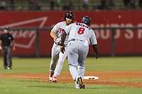 AFL East left fielder Austin Listi (23), of the Scottsdale Scorpions and Philadelphia Phillies organization, is congratulated by manager Tommy Watkins (8) after hitting a go-ahead three-run home run in the eighth inning of the Arizona Fall League Fall Stars game at Surprise Stadium on November 3, 2018 in Surprise, Arizona. The AFL West defeated the AFL East 7-6 . (Zachary Lucy/Four Seam Images)