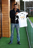 Monday, 27 January 2014<br /> Pictured: David Ngog with the Swansea City FC shirt at the club's training ground.<br /> Re: Premier League side Swansea City have bought 24-year-old French striker David Ngog from Bolton Wanderers