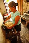 Women milling corn.Suchitoto, El Salvador