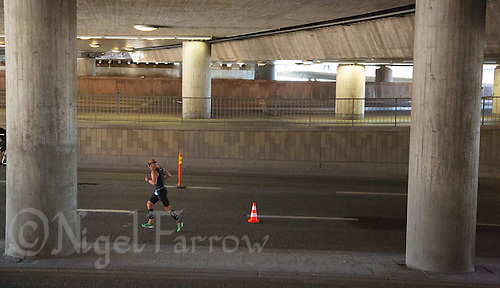 25 AUG 2013 - STOCKHOLM, SWE - A competitor runs under a railway bridge during the Stockholm Triathlon in Stockholm, Sweden (PHOTO COPYRIGHT © 2013 NIGEL FARROW, ALL RIGHTS RESERVED)