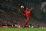 Georginio Wijnaldum of Liverpool jumps up to control the ball during the Premier League match at the Anfield Stadium, Liverpool. Picture date: November 26th, 2016. Pic Simon Bellis/Sportimage