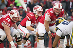 Wisconsin Badgers quarterback Alex Hornibrook (12) receives the snap from center Tyler Biadasz (61) during an NCAA College Big Ten Conference football game against the Michigan Wolverines Saturday, November 18, 2017, in Madison, Wis. The Badgers won 24-10. (Photo by David Stluka)
