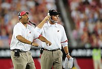 Aug. 22, 2009; Glendale, AZ, USA; Arizona Cardinals defensive backs coach Teryl Austin (left) and head coach Ken Whisenhunt against the San Diego Chargers during a preseason game at University of Phoenix Stadium. Mandatory Credit: Mark J. Rebilas-