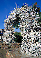 A massive arch has been built out of large elk antlers. Jackson Hole Wyoming.